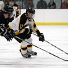 Bishop Fenwick junior forward Brian Bassett carries the puck into the offensive zone while being pursued by a St. Mary's player on Saturday afternoon. David Le/Staff Photo