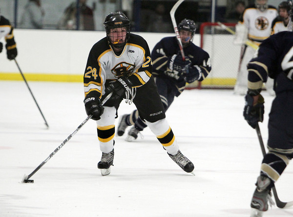 Bishop Fenwick junior forward Nick Finan carries the puck up ice against St. Mary's of Lynn on Saturday afternoon. David Le/Staff Photo