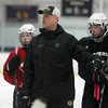 Boston Bruins Assistant Coach Doug Houda runs a drill for the Beverly High School Hockey Team at practice on Thursday evening. David Le/Staff Photo