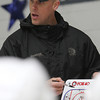 Boston Bruins Assistant Coach Doug Houda explains a drill at the Beverly High School hockey practice on Thursday evening. David Le/Staff Photo