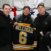 Boston Bruins Director of Media Relations and Beverly native Eric Tosi, left, and Boston Bruins Assistant Coach Doug Houda, right, present Beverly Head Hockey Coach Bob Gilligan with a personalized Bruins jersey after practice on Thursday evening at Pingree. Houda visited practice and ran through some drills with the Beverly Hockey Team. David Le/Staff Photo