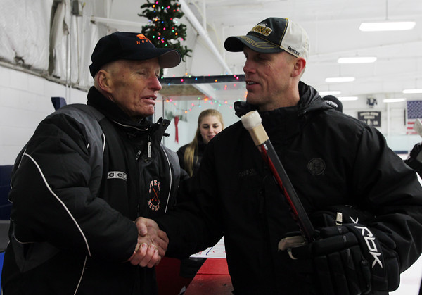 Beverly High School Head Hockey Coach Bob Gilligan, left, shakes hands with Boston Bruins Assistant Coach Doug Houda following practice on Thursday evening at Pingree School. Houda visited the Beverly HIgh practice and ran through some drills with the varsity squad. David Le/Staff Photo