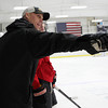 Boston Bruins Assistant Coach Doug Houda runs a drill at the Beverly High School hockey practice on Thursday evening. David Le/Staff Photo