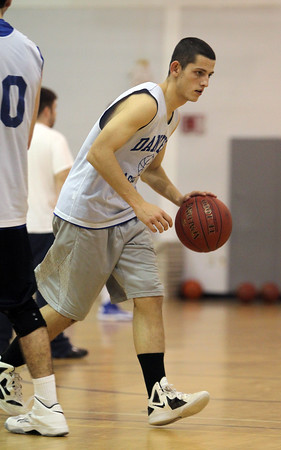Danvers senior point guard Eric Martin runs a play at practice on Wednesday evening. David Le/Staff Photo