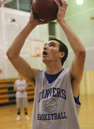 Danvers senior Dan Connors glides in for a layup at practice. David Le/Staff Photo