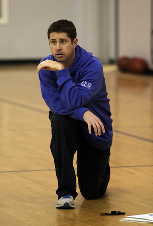 Danvers Head Coach John Walsh looks to lead the Falcons to another State Title this winter. David Le/Staff Photo