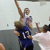 Danvers senior Nick Bates blocks a teammates shot at practice on Wednesday evening. David Le/Staff Photo