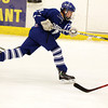 Danvers junior Trevor Daly rifles a shot on net against Marblehead on Saturday afternoon. David Le/Staff Photo