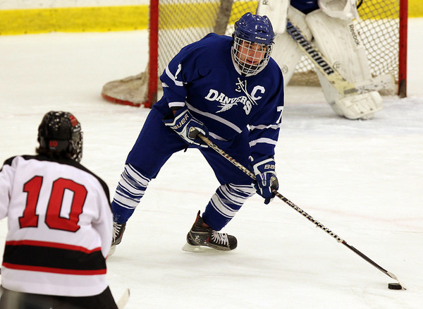 Danvers senior captain Rob Buchanan controls the puck against Marblehead on Saturday afternoon. David Le/Staff Photo