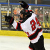 Marblehead senior forward Joe Newall pumps his fists in the air after scoring a second period goal to put the Headers up 1-0 over Danvers. David Le/Staff Photo