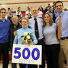 Peabody High School Head Girls Basketball Coach Jane Heil with her family after collecting her 500th win on Thursday night against Everett. David Le/Staff Photo