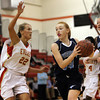 Peabody freshman point guard Sara Hosman, right, drives to the hoop while being closely defended by Everett senior Jess Wade, left, on Thursday evening. David Le/Staff Photo