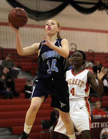 Peabody High School freshman point guard Sara Hosman glides in for an easy bucket after recording a steal and outracing Everett sophomore Yemi Okhihan down the floor. David Le/Staff Photo