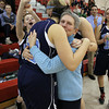 Peabody High School Girls Basketball Head Coach Jane Heil, center, gets a hug from juniors Amanda Matthews, left, and Olivia Summit, right, after a 45-28 victory over Everett on Thursday night, notching Heil's 500th career win. David Le/Staff Photo