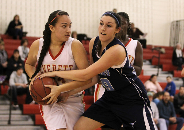 Peabody junior Amanda Matthews, right, reaches in to grab hold of the ball from Everett's Camila DaSilva and forces a jump ball on Thursday evening. David Le/Staff Photo