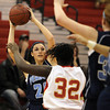 Peabody junior forward Amanda Matthews, left, looks to pass the ball into the post while being defended by Everett senior Daphnica Nazaire, right, on Thursday evening. David Le/Staff Photo