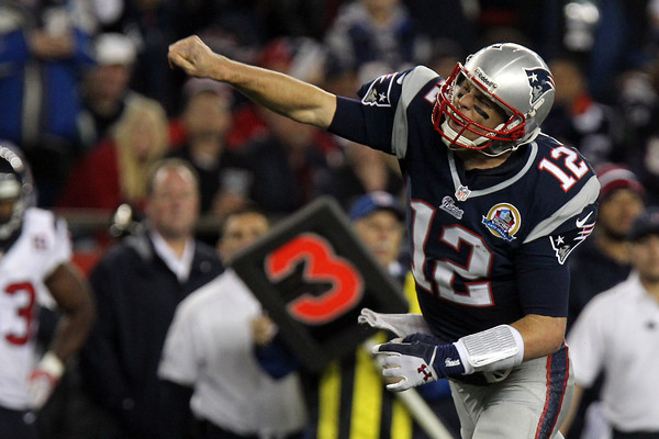New England Patriots quarterback Tom Brady pumps his fist emphatically, signaling a first down after he scrambled for 12 yards against the Houston Texans to move the chains. Brady was 21/35 for 296 yards and 4 touchdowns, as he led the Patriots bye the Texans in a battle of two of the top teams in the AFC.  David Le/Staff Photo