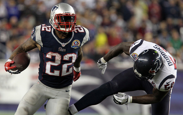 New England Patriots running back Stevan Ridley shakes off Texans linebacker Tim Dobbins, right, on a 16-yard gain in the 4th quarter of play on Monday Night Football. The Patriots defeated the Houston Texans 42-14 in dominating fashion at Gillette Stadium in Foxborough.  David Le/Staff Photo