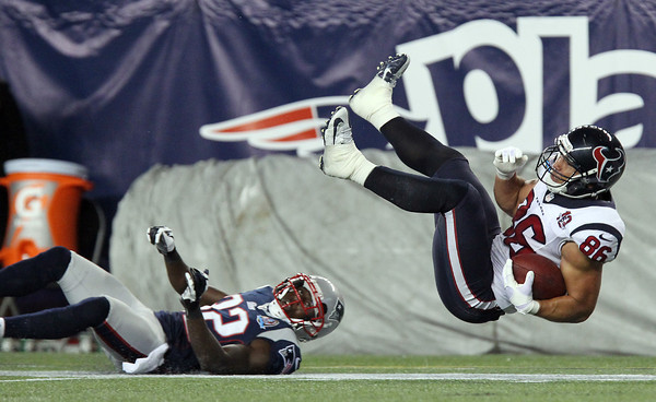 Houston Texans full back James Casey, goes airborne after being upended by New England Patriots safety Devin McCourty.  David Le/Staff Photo