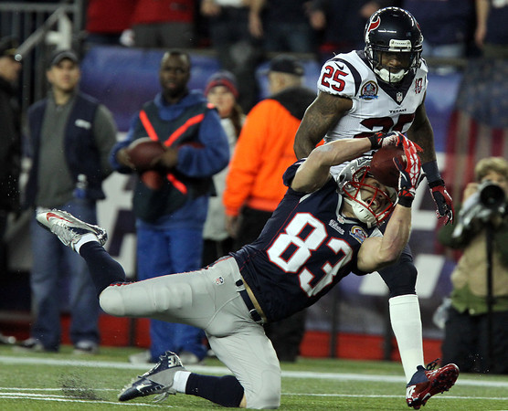 New England Patriots wide receiver Wes Welker makes a leaping catch against the Houston Texans on Monday Night Football.  David Le/Staff Photo