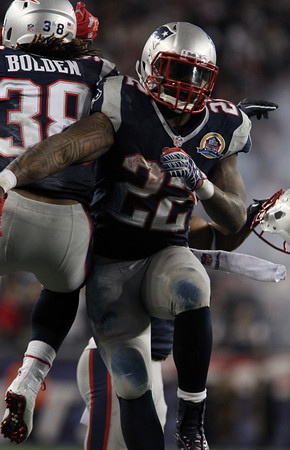 New England Patriots running back Stevan Ridley celebrates his 4th quarter touchdown with teammate Brandon Bolden, left, on Monday night against the Houston Texans. David Le/Staff Photo
