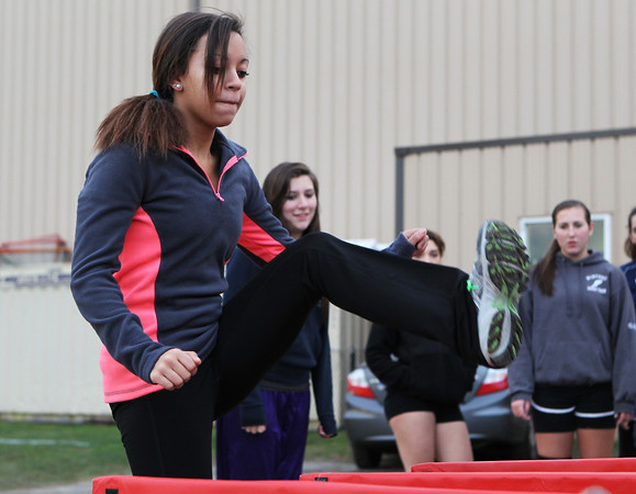 North Shore Tech/Essex Aggie freshman Rose Crispin practices the high hurdles at practice on Wednesday afternoon. David Le/Staff Photo