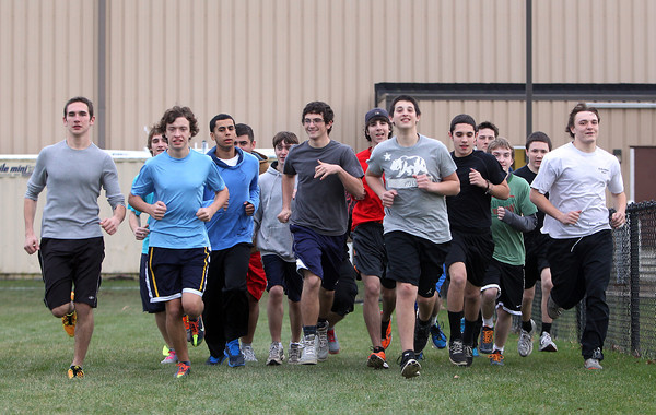The North Shore Tech/Essex Aggie boys track team warms up for practice on Wednesday afternoon. David Le/Staff Photo