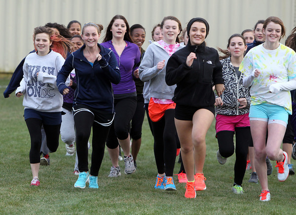The North Shore Tech/Essex Aggie girls track team warms up for practice on Wednesday afternoon. David Le/Staff Photo