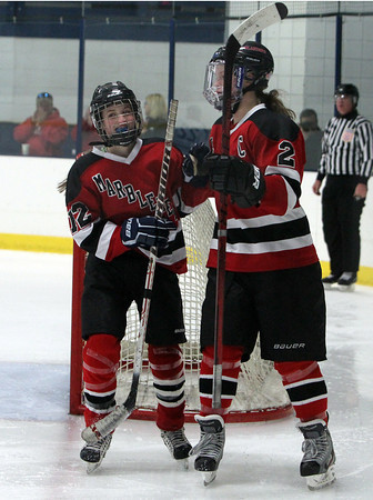 Marblehead captain Rachel McKay, right, congratulates sister Halle McKay, left, on her second period goal against Peabody on Wednesday evening. David Le/Staff Photo