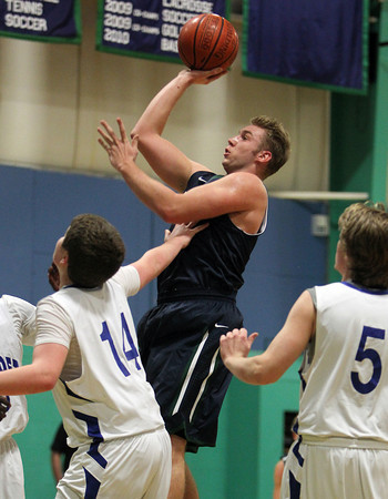 Pingree junior captain Kyle Lentini drives into the lane and releases a floater in the middle of a few Bancroft defenders during the first half of play on Friday afternoon. David Le/Staff Photo
