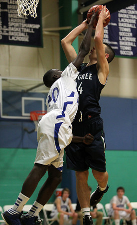 Pingree freshman guard Justin Assad, right, gets fouled while driving to the rim by Bancroft guard PJ Lidonde, left, on Friday afternoon. David Le/Staff Photo
