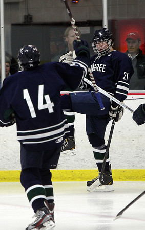 Pingree junior Chris Usseglio, right, pumps his fist after scoring a powerplay goal to put the Highlanders up 5-1 over Moses Brown on Wednesday evening. David Le/Staff Photo