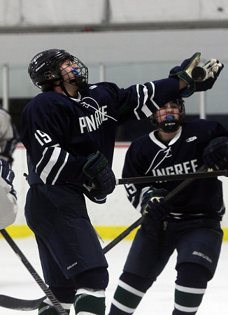 Pingree junior Brandon Franco gloves down a loose puck in the offensive zone against Moses Brown on Wednesday evening. David Le/Staff Photo