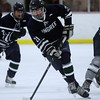 Pingree junior Chris Usseglio carries the puck into the offensive zone against Moses Brown on Wednesday evening. David Le/Staff Photo