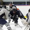 Pingree junior Brandon Franco dives forward to jarr a puck loose from the Moses Brown goalie on Wednesday evening. David Le/Staff Photo