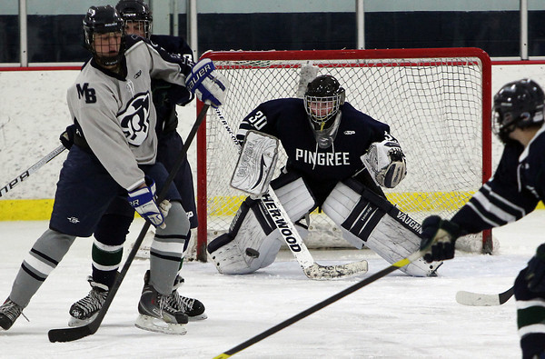 Pingree sophomore goalie Chris DeVito keeps his eyes on the puck as it finds its way through a crowd of players against Moses Brown on Wednesday evening. David Le/Staff Photo