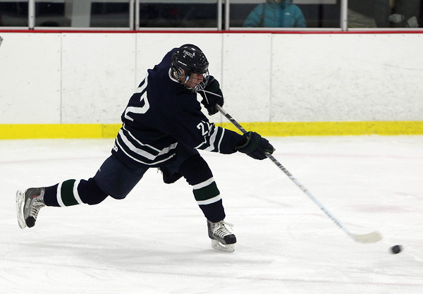 Pingree senior Jerome Cappadona fires a shot on net against Moses Brown on Wednesday evening. David Le/Staff Photo