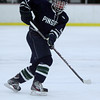 Pingree freshman Ryan Lovell slides the puck to a teammate on Wednesday evening against Moses Brown. David Le/Staff Photo