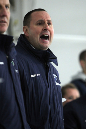 New Pingree Head Coach Gino Khachadourian yells instructions to his team. David Le/Staff Photo