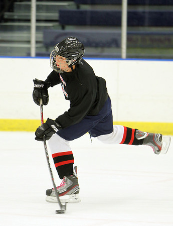 Salem High School's Jake Stahlman rips a shot on net during practice on Friday afternoon.David Le/Staff Photo
