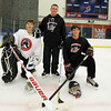 The Salem High School Boys Hockey team will be led by new head coach Ted Henley, center, and captains junior Brett Herring, left, and senior Jake Batista, right, in the 2012-2013 hockey season. David Le/Staff Photo