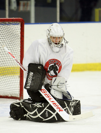 Junior captain and starting goalie Brett Herring makes a save at practice on Friday afternoon. David Le/Staff Photo