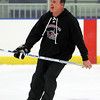 First year head coach Ted Hanley shouts instructions at practice on Friday afternoon.  David Le/Staff Photo