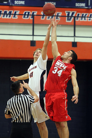 Salem State junior Trey Morin, left, and WPI junior Ryan Kolb, right, battle for the tipoff of Tuesday evening's game. David Le/Staff Photo