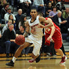Salem State senior Justin Nieves drives to the hoop after getting past WPI sophomore Matt Harrington, right, on Tuesday evening. David Le/Staff Photo