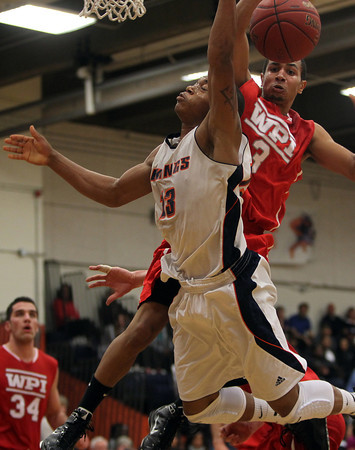 Salem State freshman Anthony Hodgers, left, loses the ball after being fouled by WPI freshman Aaron Davis, right, on Tuesday night. David Le/Staff Photo