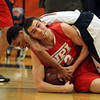 Salem State junior guard Andrew White, left, gets tangled up with WPI sophomore Marco Coppola as they battle for a loose ball on Tuesday night. David Le/Staff Photo