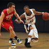 Salem State freshman Anthony Hodges, right, looks to drive to the hoop against WPI sophomore Marco Coppola, left, on Tuesday evening. David Le/Staff Photo