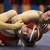 St. John's Prep junior Fred Colberg, right, gets St. John's Shrewsbury junior Alex O'Connor in a headlock during the 132 lb wrestling match on Wednesday evening at St. John's Prep. David Le/Staff Photo