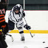 St. John's Prep senior forward Brian Pinho rifles a slap shot on net against Woburn on Saturday afternoon. Pinho netted a backhanded goal with less than a minute to play in the third period to seal a 4-2 victory at Ristuccia Arena. David Le/Staff Photo